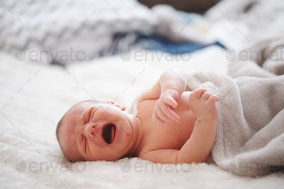 cute newborn baby at home