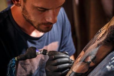Bearded tattoo male artist