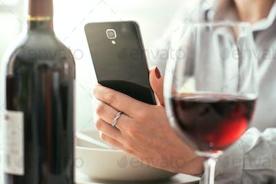 Woman using a wine app