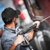 Driver Washing His Semi Truck