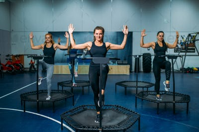 Women group doing fit exercise on sport trampoline