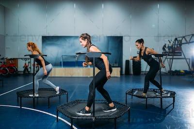Women group on sport trampoline, fitness workout