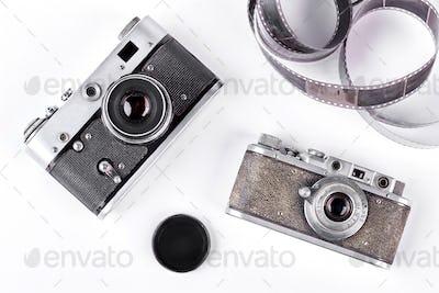 Obsolete cameras on white background