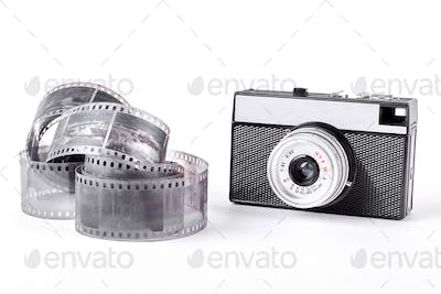 Old camera and tape on white background