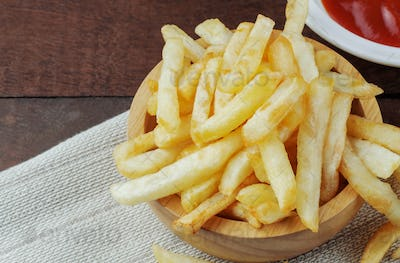 French fries on wooden