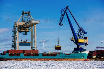 Industrial port with containers, vessel loading in port of Finland