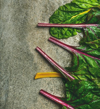 Flat-lay of fresh leaves of swiss chard, vertical composition