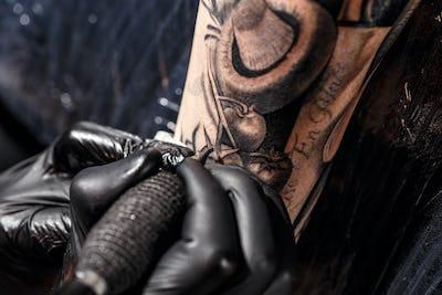 Close up tattoo artist