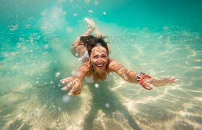 Cute Girl Swimming Under Sea