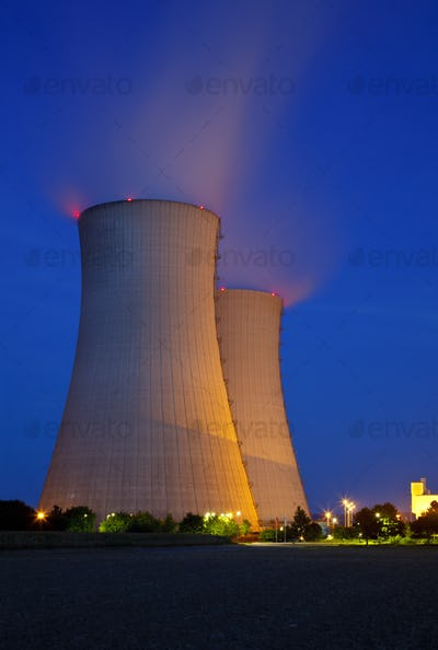 Illuminated Cooling Towers At Night