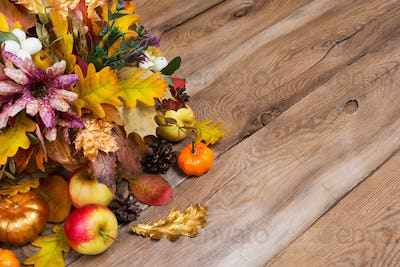 Rustic fall background with golden pumpkin and oak leaves