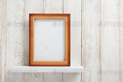 photo picture frame at wooden shel