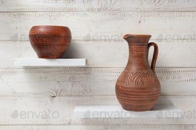 clay jug and pot at shelves