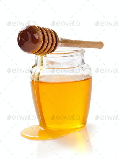 jar of honey on white background