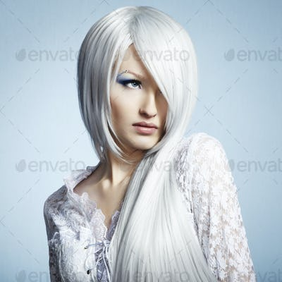 Fashion portrait of a young beautiful blonde woman. Winter Makeu