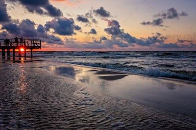 Sunset over wooden pier