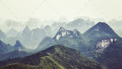 Retro toned picture of karst formations landscape around Guilin.