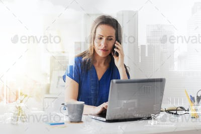 woman calling on smartphone at office