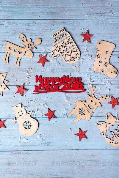 """Christmas wooden with hanging toys and """"Merry Xmas"""" greeting text written with small red letters"""