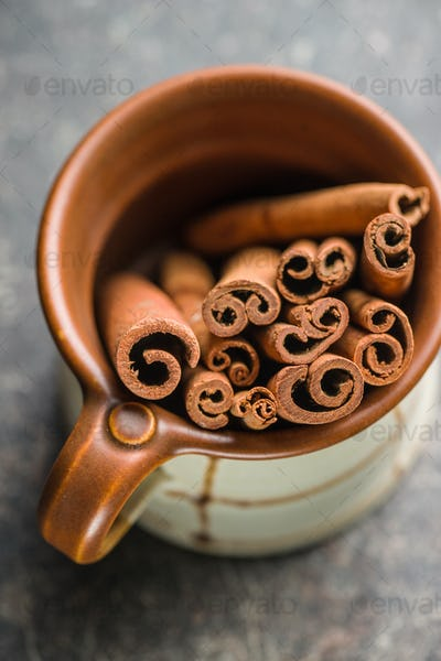 Cinnamon sticks in cup.