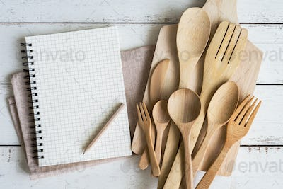 Blank notebook with wooden utensil