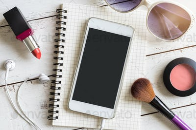 Smartphone with Blank screen on notebook and makeup