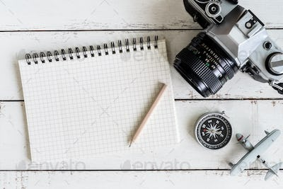 Traveler's accessories and items with notebook and copy space