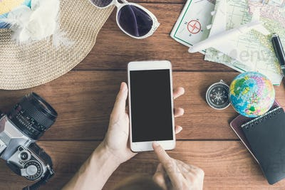 Traveler's accessories and items with cellphone