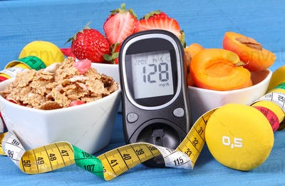 Glucose meter with result sugar level, healthy food, dumbbells and centimeter, diabetes