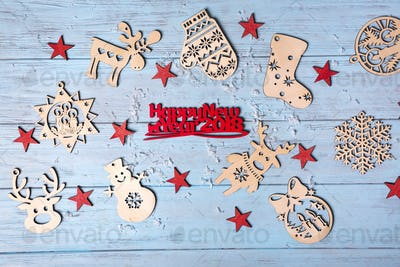 wooden hanging toys and Merry Christmas greeting small red letters