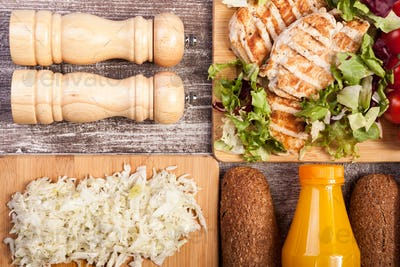 Delicious grilled chicken on wooden board