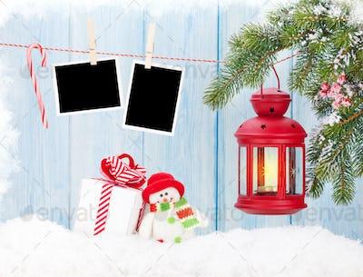 Christmas candle lantern, gift box and blank photos