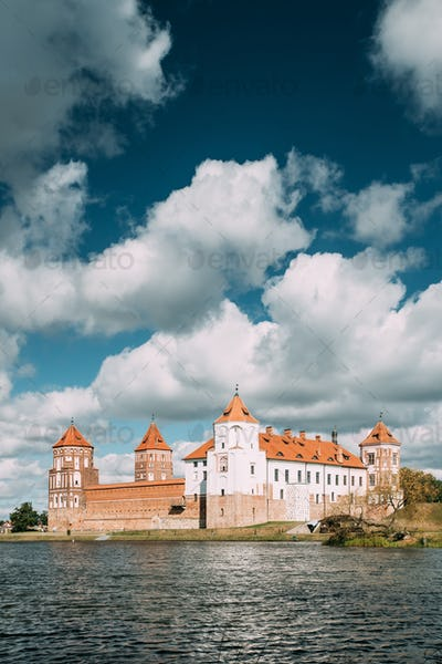Mir, Belarus. Mir Castle And Lake In Summer Sunny Day. Cultural