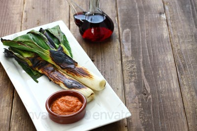 roasted calcots with romesco sauce for dipping, spanish catalan cuisine