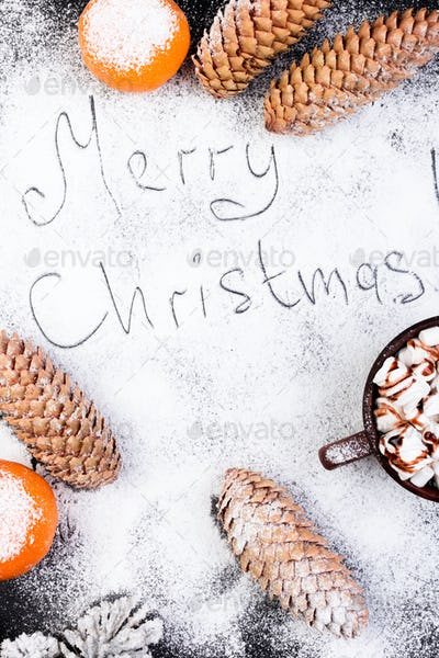 Merry Christmas Handmade Text on Snow. Christmas Food Sweet Marshmallow with Chocolate in Brown Cup
