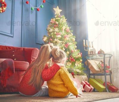 sisters near Christmas tree