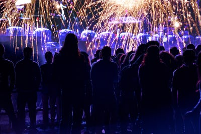 Crowd and fireworks. New Year concept