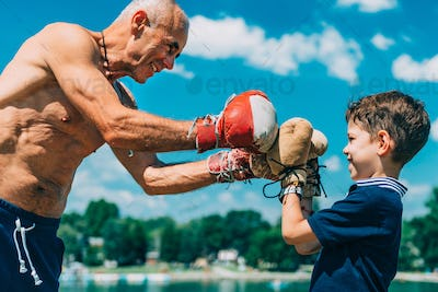 Small boxer with senior trainer