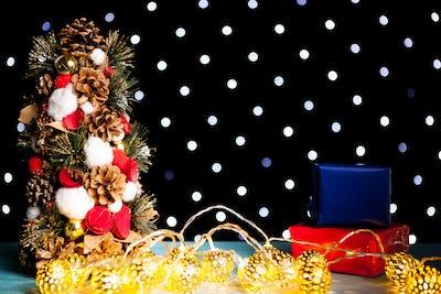 Christmas mini tre on festive bokeh light