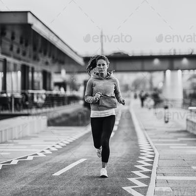 Woman jogging on riverside