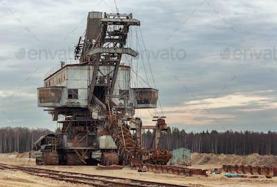 Broken giant quarry excavator