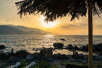 Inspirational beautiful sunrise landscape at sea and mountains