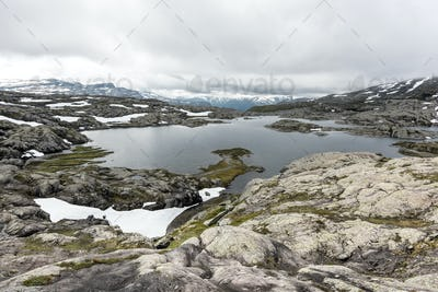 Typical norwegian landscape with snowy mountains