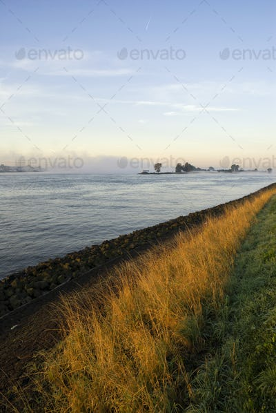 Mist above the river Merwede near Boven-Hardinxveld in the Dutch region Alblasserwaard