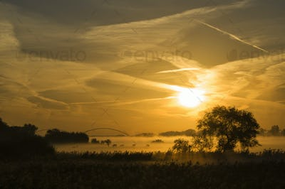 Sunrise above the river Merwede near Boven-Hardinxveld in the Dutch region Alblasserwaard