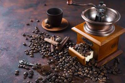 still life of coffee beans with coffee grinder