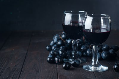 Red wine in glasses with grape