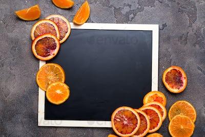 orange rings on a black chalkboard.