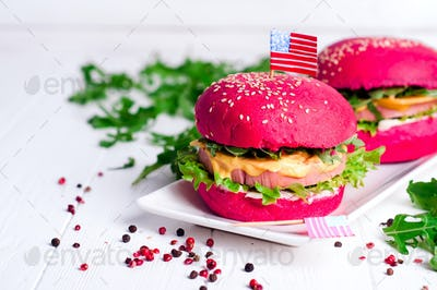 two tasty hamburgers with little American flags