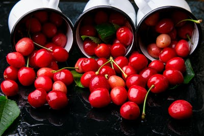 Scattered cherry from enamel cups